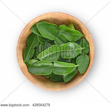 Top View Of Kaffir Lime Leaves In Wooden Bowl On White Background