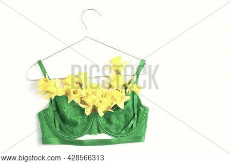 Womens Lace Bra Of Green Color And Fresh Spring Flowers On A White Background, Top View, Flat Lay. M