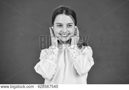Favorite Tune. Home Schooling Online Education. Back To School. Small Girl In Headphone At Blackboar