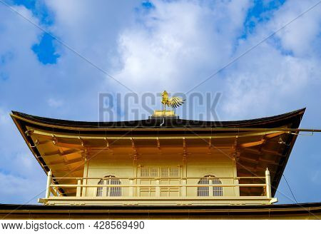Close Up Golden Pavilion Roof Top With Gold Phoenix  On Top In Kinkakuji Temple ,famous Tourist Dest