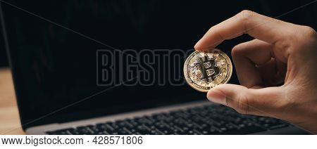 Investor Businessman Holding A Golden Bitcoin On Dark Background, Trading, Cryptocurrency, Digital V