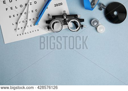 Different Ophthalmologist Tools On Grey Background, Flat Lay. Space For Text