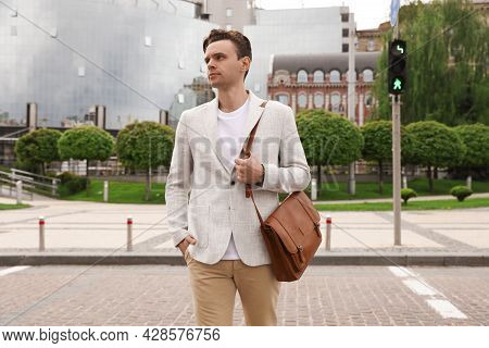Young Man Crossing Street. Traffic Rules And Regulations