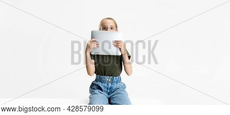 Flyer. One Smart Teen School Caucasian Girl In Casual Clothes And Glasses Holding Tablet Isolated Ov