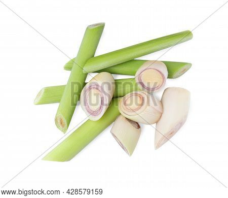 Whole And Cut Fresh Lemongrass On White Background, Top View