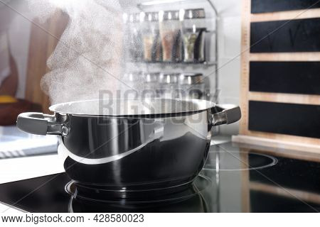 Steaming Pot On Electric Stove In Kitchen