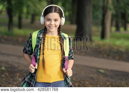 Happy Kid Listen To Audio Course In Modern Headphones Carrying School Bag In Casual Fashion Style Na