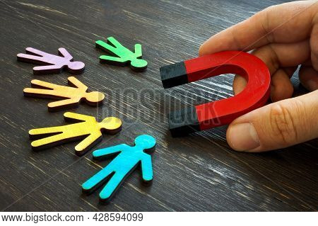 Retention Marketing Concept. The Manager Holds A Magnet For Customers.