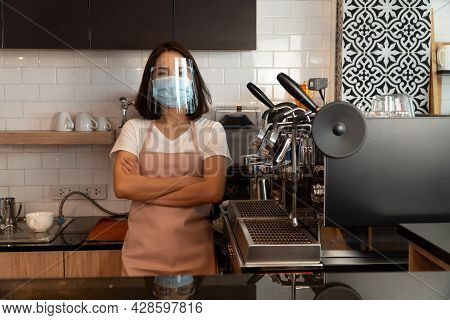 Portrait Of A Happy Woman Asian Waitress Wearing A Face Mask And  Standing At A Coffee Shop, Small B