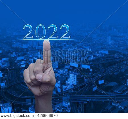 Hand Pressing 2022 Text Over Modern City Tower Office, Street, Expressway And Skyscraper, Business H