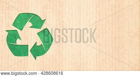 Arrows recycle symbol on striped cardboard texture. Horizontal or vertical banner with eco paper texture. Paper cardboard background. Recycled carton material. Copy space for text. Mock up template