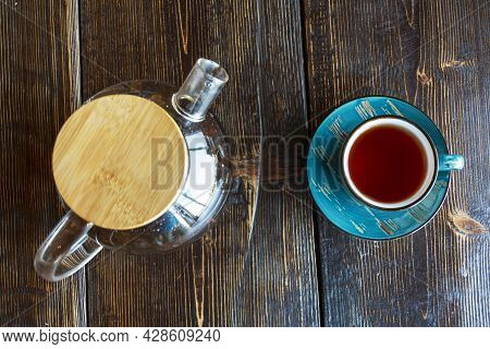 Tea In A Glass Teapot And A Cup Of Tea On A Rough Wooden Table In A Cafe, Brunch. Fresh Tea, Calm. T