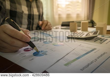 Analyst Brokers Or Businessman Are Analyzing Statistical Charts On Real Estate Share, The Housing Ma