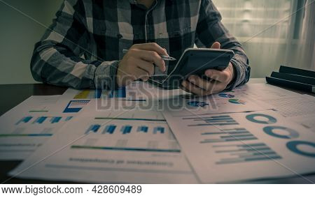 Accountant Or Businessman Hand Holding Calculator And Calculate Statistic Financial,  Tax, Income, L
