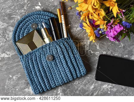 Blue Cosmetic Bag With Different Cosmetics Flowers Phone