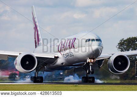 Amsterdam, Netherlands - August 14, 2014: Qatar Airways Cargo Plane At Airport. Freighter Flight And