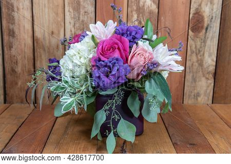 Beautiful Bouquet Of Arranged Pink Roses And Other Colorful Flowers In A Vase Given As An Emotional