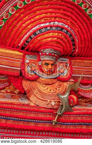 Payyanur, India - December 3, 2019: Portrait of an unidentified Theyyam dancer during temple festival in Payyanur, Kerala, India. Theyyam is a popular ritual form of worship in Kerala, India