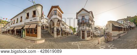 Gjirokastra, Albania - June 24, 2021: Big panorama with historic buildings at the center of historic town of Gjirokaster, Albania. World Heritage Site by UNESCO