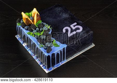 Beautiful Delicious Birthday Cake On A Dark Wooden Background, With Berries And Dark Chocolate. With