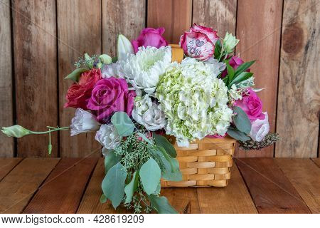 Beautiful Basket Bouquet Of Arranged Roses And White Flowers Given As An Emotional Sentiment Of I Lo