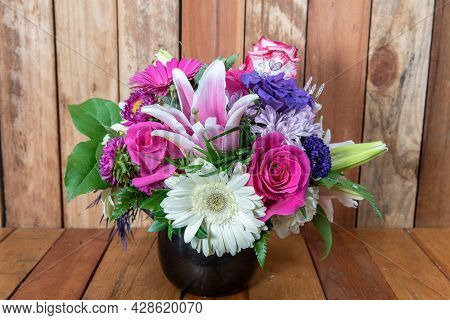Beautiful Bouquet Of Arranged Stargazers, Roses, Mums, And White Daisys Displayed In A Lovely Vase.