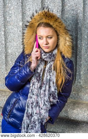 Calling Outside. Dressing In A Blue Down Hooded Jacket With Trim Faux Fur, Hood Covering Head, Long