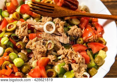 Tasty Tuna Salad With Vegetables On Wooden Table. Vegetable Salad With Tuna. Preparing A Healthy Veg