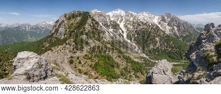 Big panorama of summit Jezerca in Albanian Alps from Valbona Pass in Valbona Valley National Park during hike from Theth to Valbona. Prokletije or Accursed Mountains in the Northern Albania