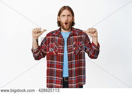 Shocked Blond Guy Pointing At Himself With Concerned Face Expression, White Background