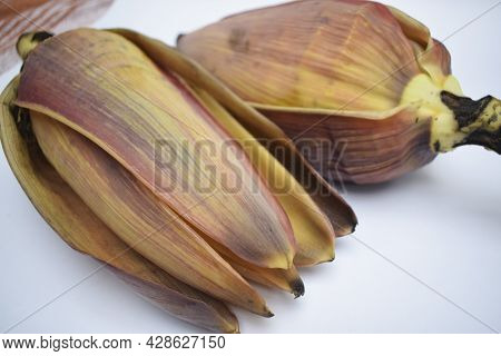Raw Banana Flower Also Known As Banana Blossom Or Banana Heart On White Background. Curry Sabji Sout