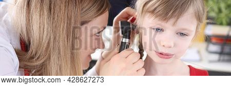 Doctor Examines Ear With An Otoscope To Little Girl