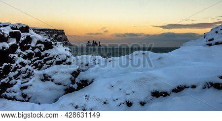 Reynisfjara Volcanic Beach With Basalt Sculpture Columns Raises Up From The Sea. Iceland, Europe.