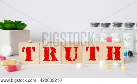 The Word Truth Is Written On A Wooden Cubes Structure. Blocks On A Bright Background. Can Be Used Fo