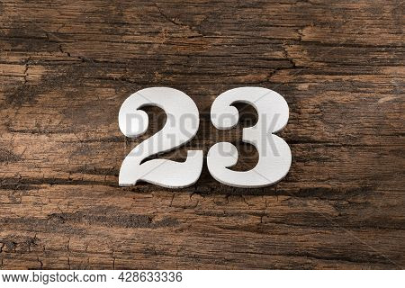 Twenty Three 23 - White Wooden Number On Rustic Background