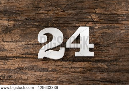 Number Twenty Four 24 - White Piece On Rustic Wood Background