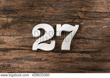 Twenty Seven 27 - White Wooden Number On Rustic Background
