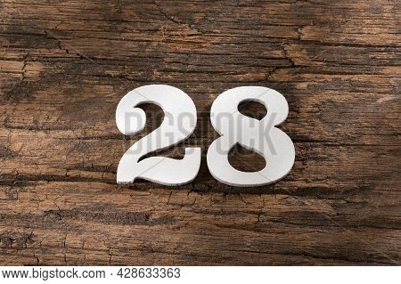 Number Twenty Eight 28 - White Piece On Rustic Wood Background