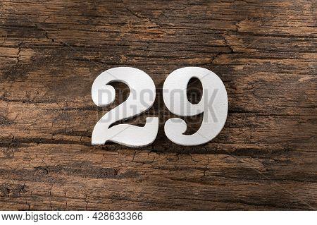 Twenty Nine 29 - White Wooden Number On Rustic Background