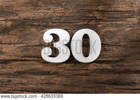 Number Thirty 30 - White Piece On Rustic Wood Background