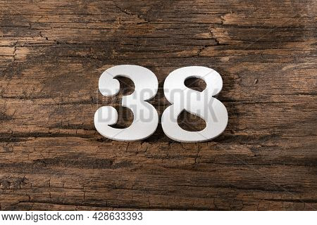 Number Thirty Eight 38 - White Piece On Rustic Wood Background