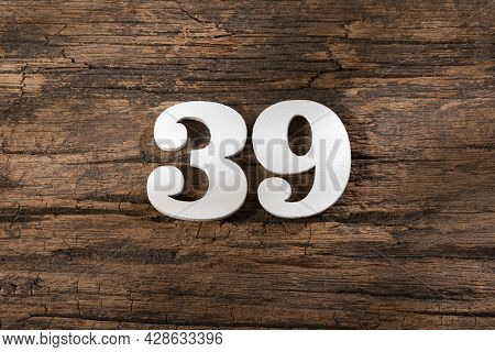 Thirty Nine 39 - White Wooden Number On Rustic Background