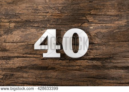 Number Forty 40 - White Piece On Rustic Wood Background