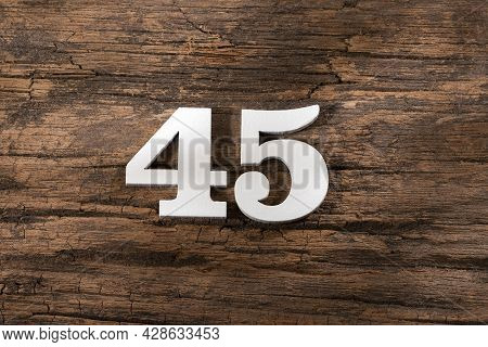 Forty Five 45 - White Wooden Number On Rustic Background
