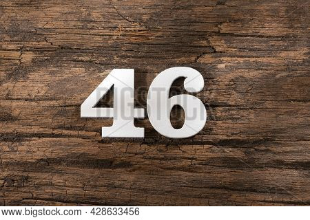 Number Forty Six 46 - White Piece On Rustic Wood Background