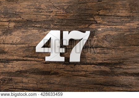 Forty Seven 47 - White Wooden Number On Rustic Background