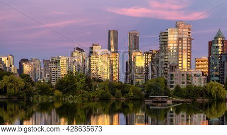 View Of Lost Lagoon In Famous Stanley Park In A Modern City With Buildings Skyline In Background. Co