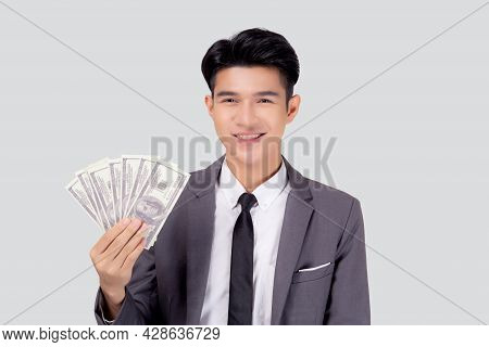 Young Asian Business Man Holding Money Dollar Isolated On White Background, Businessman In Suit Hold
