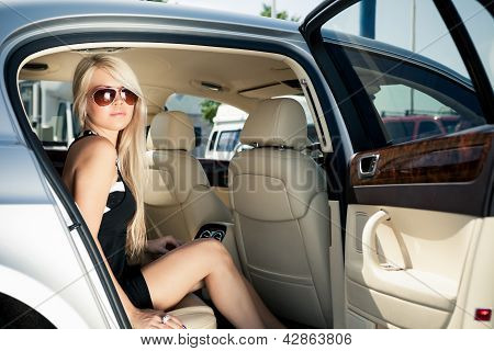 Lady in a luxury car