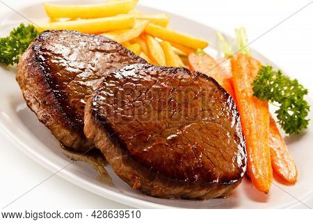 Roast Steaks With French Fries High Quality Image